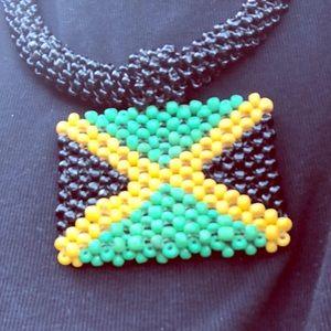 Hand beaded necklace representing JA